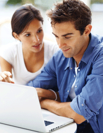 couple on laptop make money